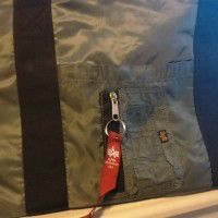 Alphaindustries jacket and a bag